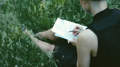 Overhead Closeup of Female Artist Drawing in Nature Stock Footage