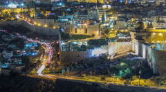 Panoramic view on Jerusalem night timelapse with traffic on the road from the Arkistovideo