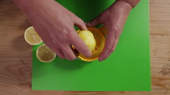 Juicing a lemon; wide top-shot Stock Footage