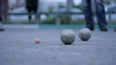 Playing bocce ball, outdoors Stock Footage