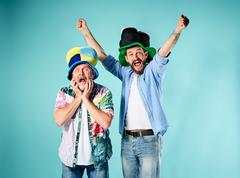 The two football fans over blue - stock photo