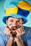 The football fan over blue - stock photo