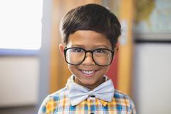 Portrait of smiling schoolboy in spectacle - stock photo