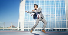 4K Young urban street dancer in smart suit showing off some moves in city - stock footage