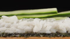 SLOW MOTION: A cucumber strips falls on a white rice - stock footage