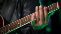 Crook pluck the strings on the guitar fretboard Stock Footage