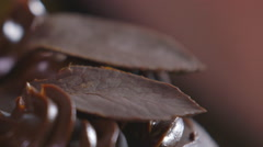 Decorating a chocolate cake with a chocolate leaf Stock Footage