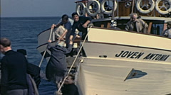 Majorca 1969: people jumping into a tourist ship Stock Footage