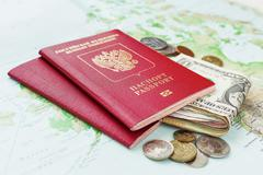 Travel background with passport, money and  map. Symbols of travelling, trip. Kuvituskuvat