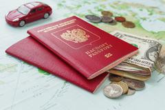 Travel background with passport, money, car and  map. Symbols of traveling by - stock photo