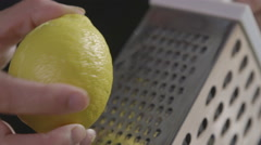 Grating a lemon Stock Footage