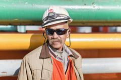 Close up of oil rig worker - stock photo