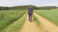 Walking Road to Succes Businessman Man in Suit Beautiful sunset 4K Ultra HD - stock footage