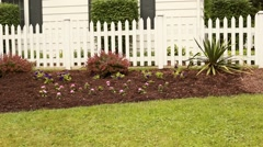 Flower bed with picket fence Stock Footage