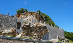 A wall built around a cliff face Stock Photos