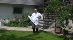 Mature Man In Apron Outdoors With The Grill Stock Footage