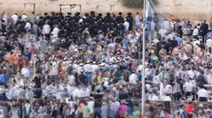 Religious Jews sunset prayer service at the Western Wall, Israel timelapse Stock Footage