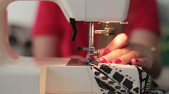 Female hands sewing use the sewing machine, close up - stock footage