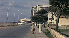 Spain 1969: women walking in front of the beach Stock Footage