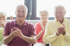 Seniors clapping hands - stock photo