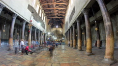 Church of the Nativity interior with hall colonnade, altar and icon lamps - stock footage