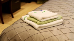 The interior of the room: three towels lying on the bed - stock footage