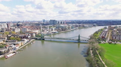 Aerial 4K Urban View of River and Bridge in City of London Stock Footage