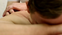Man relaxing with massage - stock footage