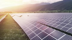 Solar Panels Farm Green Energy Aerial Flight At Sunset Orange Colors Mountains Stock Footage