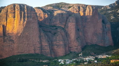 Sun setting over small northern Spanish mountain town Mallos de Riglos 4k Stock Footage