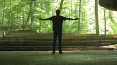 Taking a bow beautiful young man in nature track in 4K Ultra HD Stock Footage