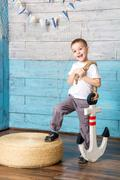 Little boy standing and holding an anchor Stock Photos