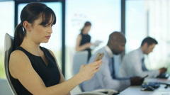 4K Bored business team in city office using cell phones for personal use - stock footage
