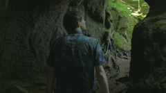 Cave Walking young adult in beautiful Nature scene 4K HD Ultra - stock footage