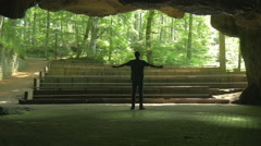 Taking a bow in Empty minde Nature Theater beautiful Nature young man bowing Stock Footage
