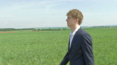 Businessman Walking in open Field To Succes and Freedom 4K - stock footage