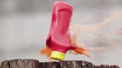 ketchup bottle gun shot in native slow motion scene - stock footage