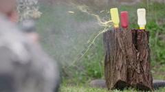 Mustard bottle gun shot in native slow motion scene on green background Stock Footage