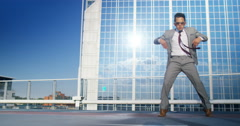 4K Young urban street dancer in smart suit showing off some moves in city Stock Footage