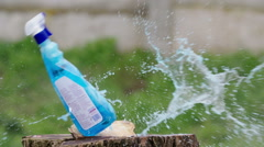 Cleaning spray bottle gun shot in native slow motion scene on green background Stock Footage