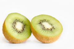 Cross section of ripe kiwi on white background Stock Photos