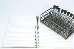 Gray laboratory tube with stainless rack on the white background. Stock Photos