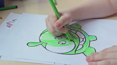 Kids drawing at kindergarten by felt pen - stock footage