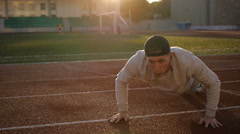 Young athletic man doing warm-up before exercise and jogging - stock footage