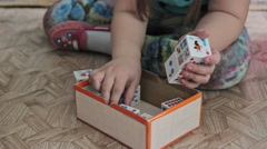 A kid playing toy blocks at home Stock Footage
