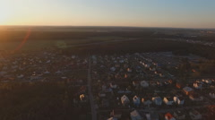Aerial view: Big Village near forest when sunset Stock Footage