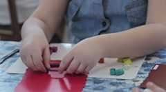 Group of kids sculpt by plasticine on table in kindergarten - stock footage