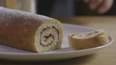 Icing sugar on a swiss roll - stock footage