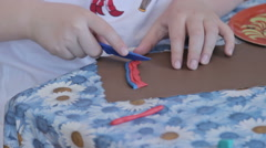 Group of kids sculpt by plasticine on table in kindergarten, close up hands - stock footage