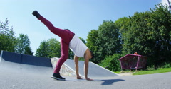 4K Young urban street dancer showing off some moves at skate park. - stock footage